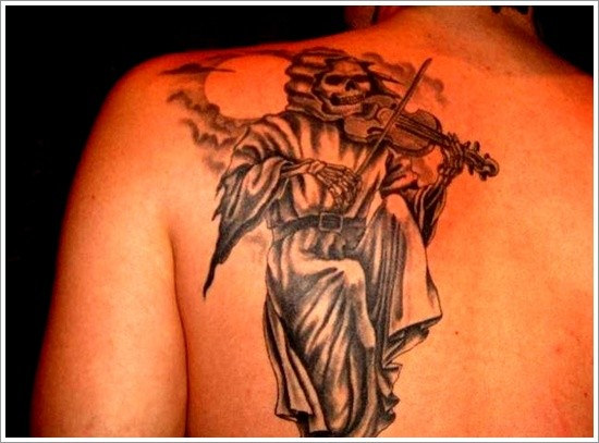 Death plays violin tattoo on shoulder blade