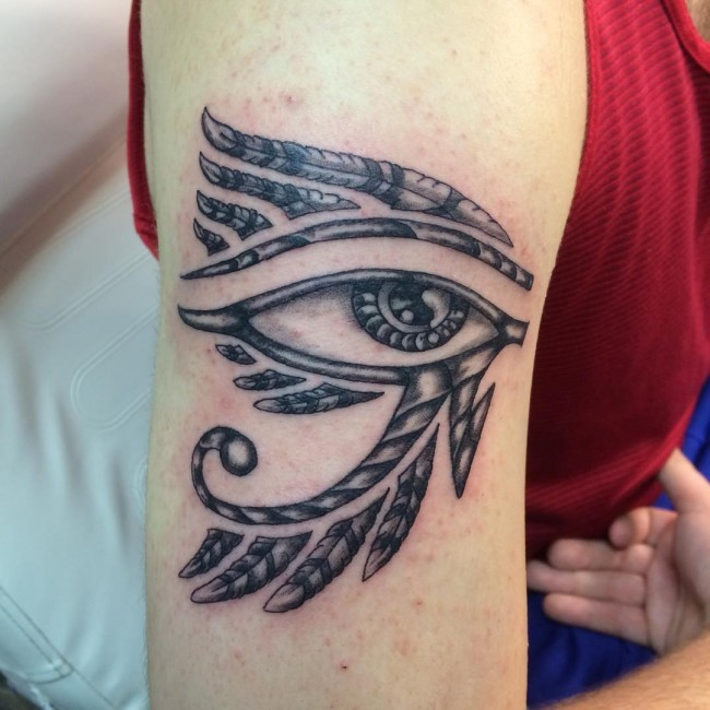 Decorated with feather Egyptian ancient symbol the Eye of Horus tattoo on shoulder