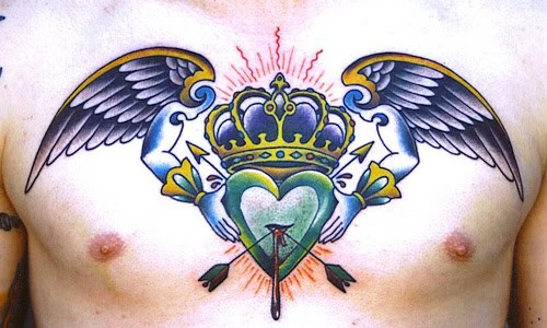 Delicate and awesome crown tattoo on chest