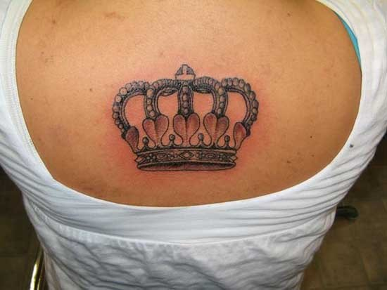 Delicate crown tattoo on upper back