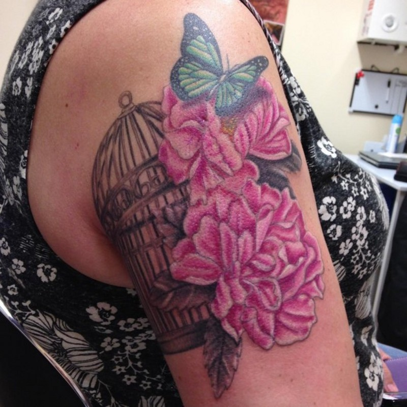 Delicate pink peony flowers, butterfly and bird cage realistic tattoo on woman&quots shoulder