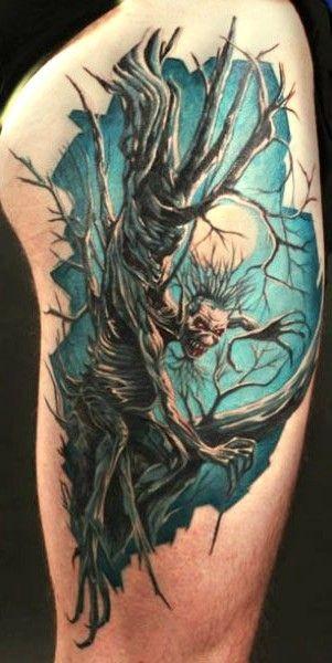 Demon tree in a full moon tattoo on half sleeve