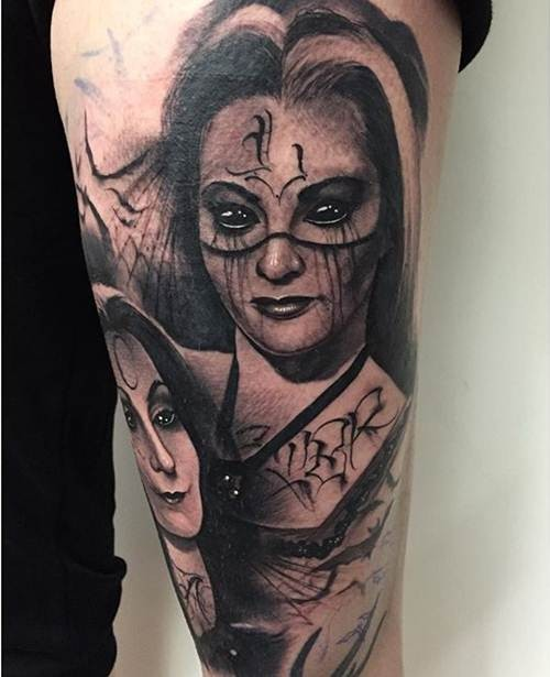 Demonic black ink forearm tattoo of of demonic woman face with bats