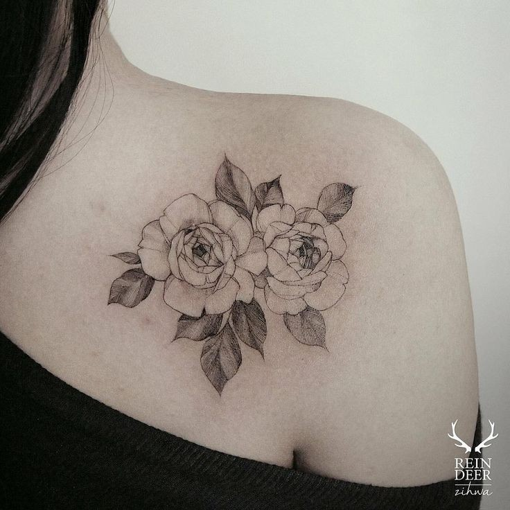 Designed by Zihwa nice looking collarbone tattoo of beautiful flowers