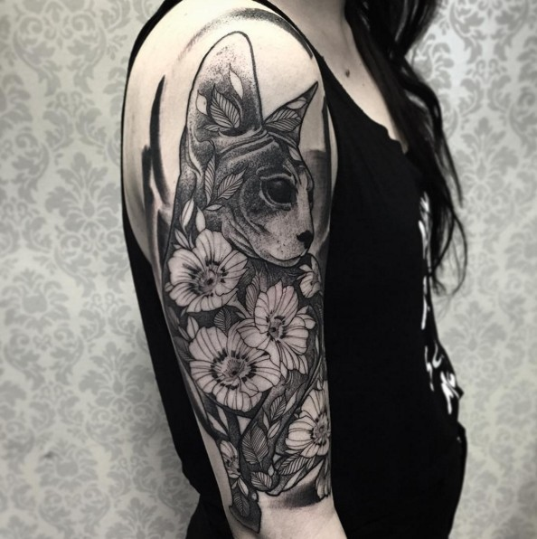 Designed cat and flowers tattoo on girl&quots shoulder in engraving style