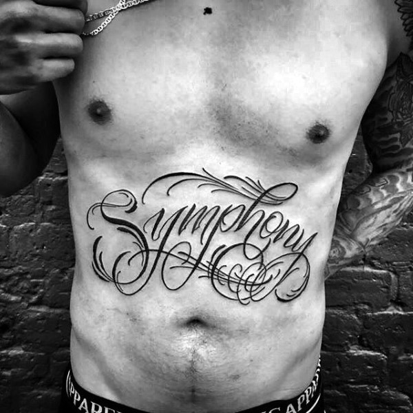 Designed dark black ink lettering Symphony belly tattoo with curls