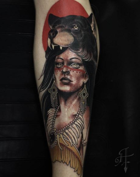 Detailed and colored forearm tattoo of Indian woman with bear helmet