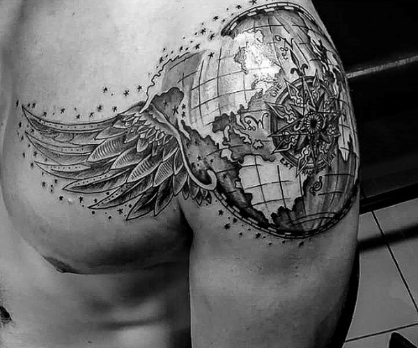 Detailed black and white shoulder tattoo of globe with wings and compass