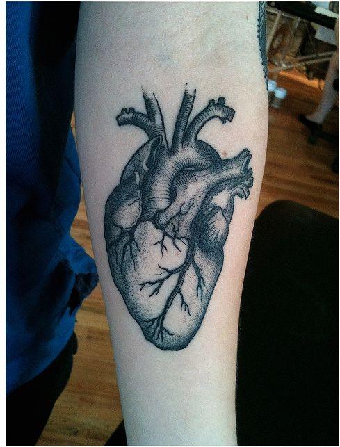 Detailed black gray anatomical heart forearm tattoo