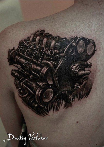 Detailed black ink scapular tattoo of big car engine