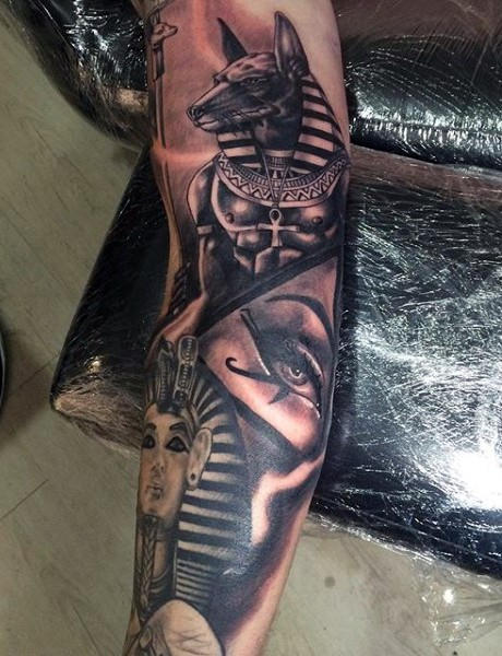 Detailed colored Egypt themed sleeve tattoo of various gods