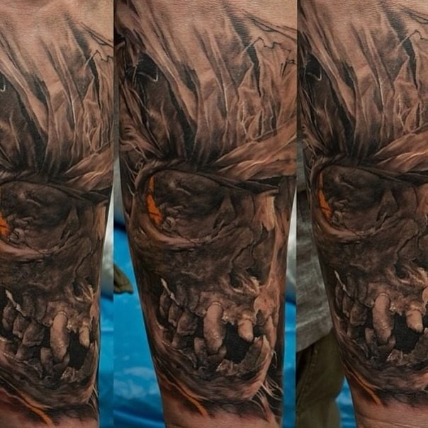 Detailed colored fantasy creepy skull tattoo on forearm