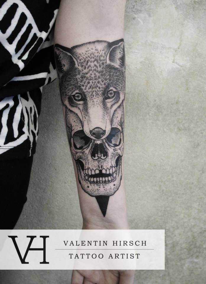 Detailed human skull with fox head arm tattoo by Valentin Hirsch