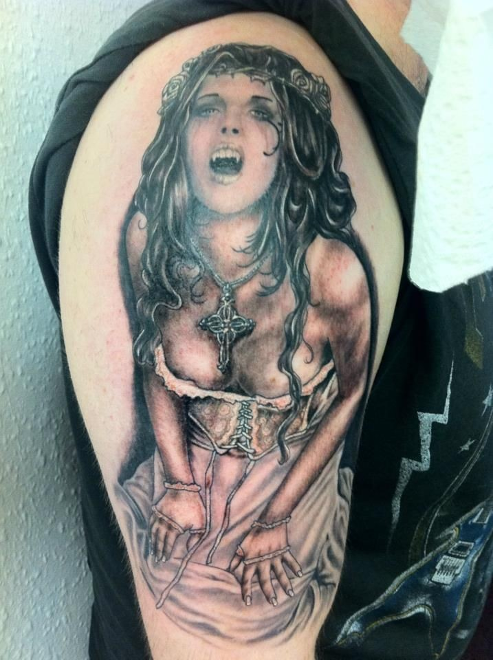 Detailed illustrative style colored shoulder tattoo of sexy medieval vampire woman