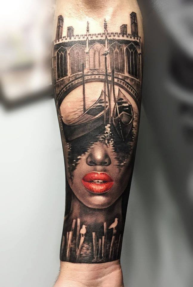 Detailed interesting looking arm tattoo of medieval city bridge with woman face