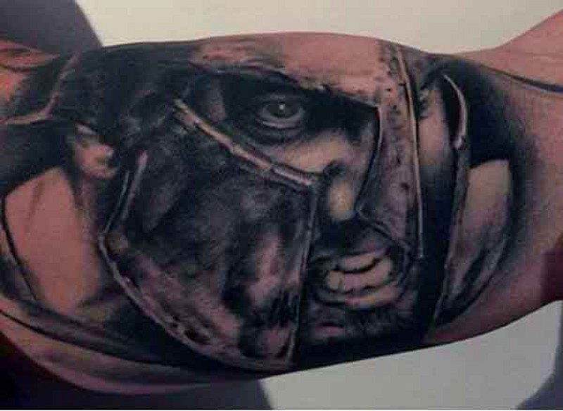 Detailed looking black and white biceps tattoo of Spartan warrior portrait