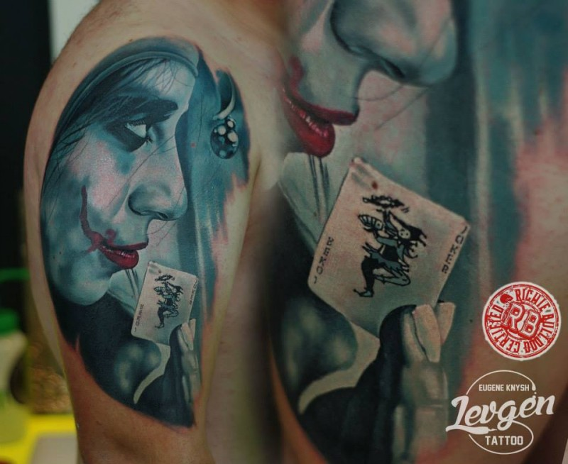 Detailed looking shoulder tattoo of Joker with playing card