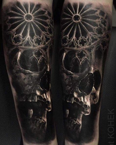 Detailed medieval style arm tattoo of human skull with ornament