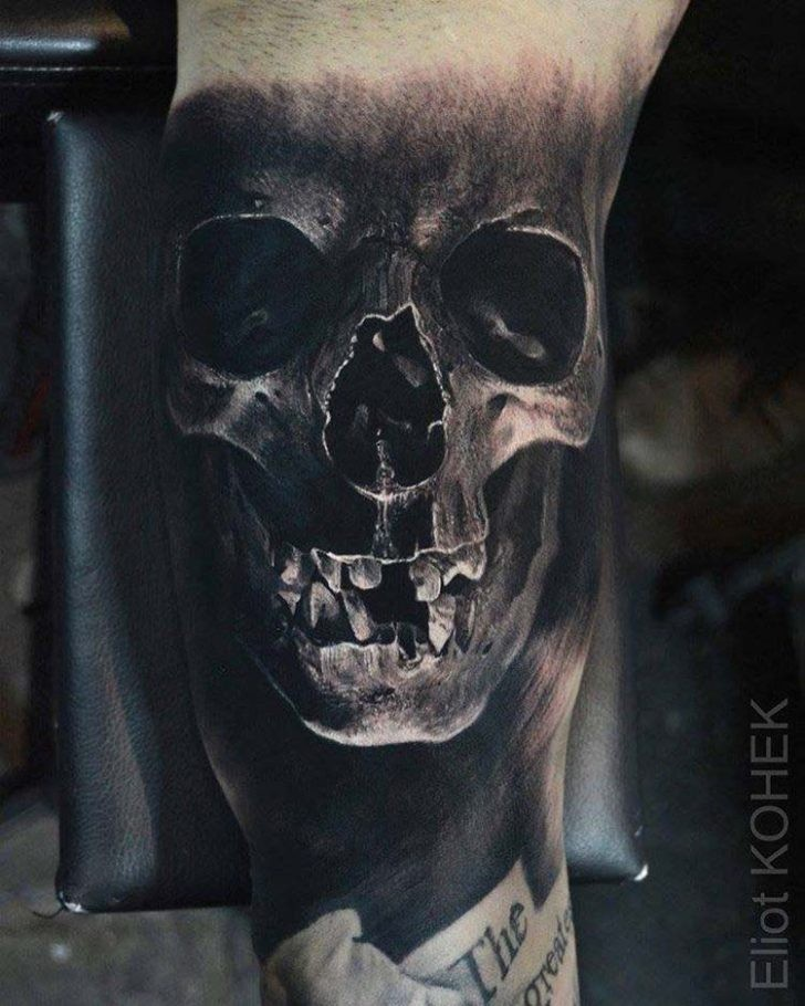 Detailed painted by Eliot Kohek arm tattoo of human skull