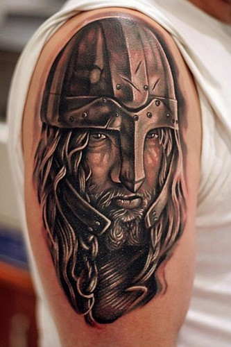 Detailed portrait of viking tattoo on half sleeve