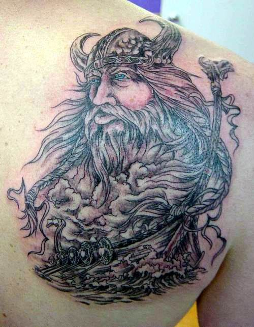 Detailed scandinavian god and vikings tattoo on shoulder blade