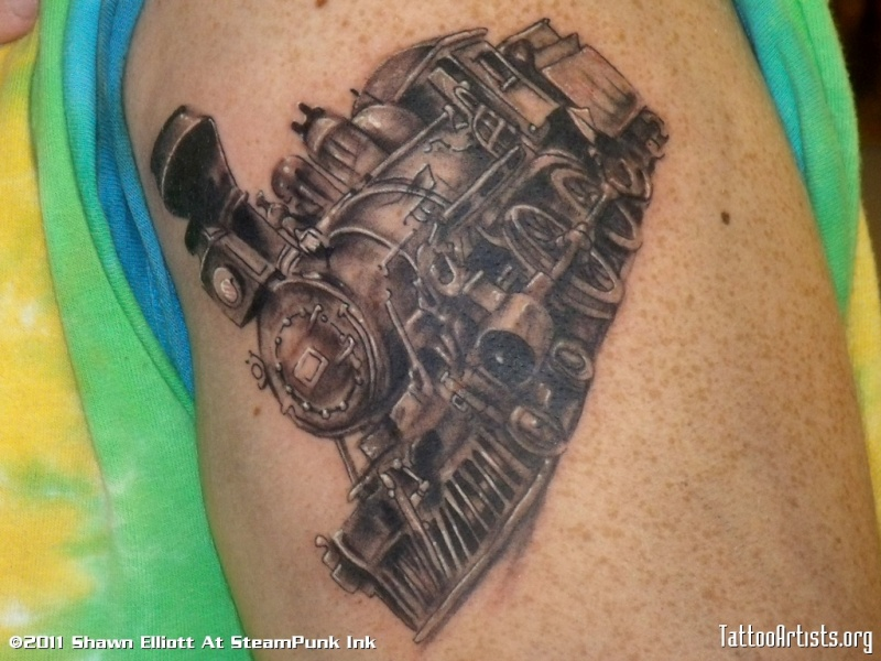 Detailed small upper arm tattoo of steam train
