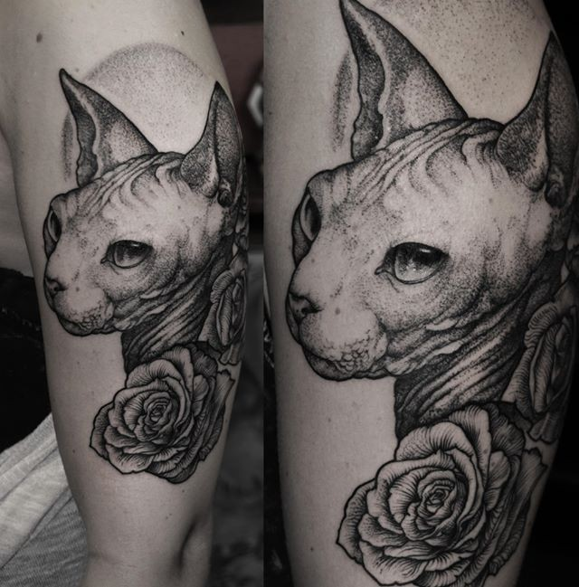 Detailed Sphinx portrait tattoo with roses on shoulder gray ink work style