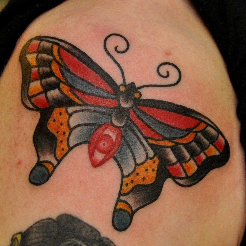Different colours traditional butterfly tattoo for female