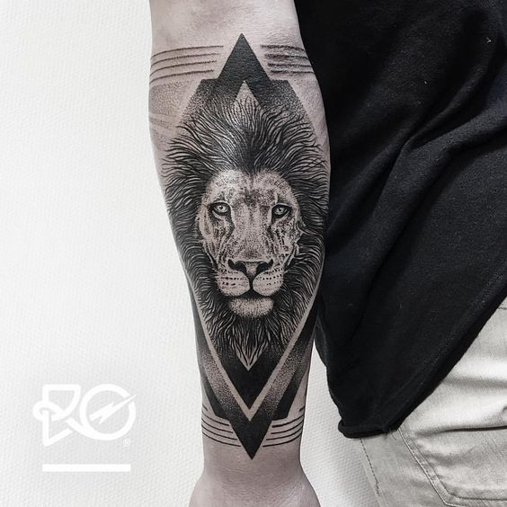 Dot style black ink arm tattoo of lion head with geometrical figures