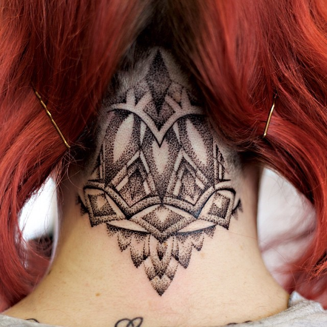 Dot style black ink Baroque style neck tattoo of various ornaments