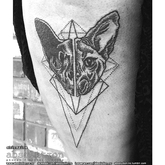 Dot style black ink demonic cat head with geometrical figures