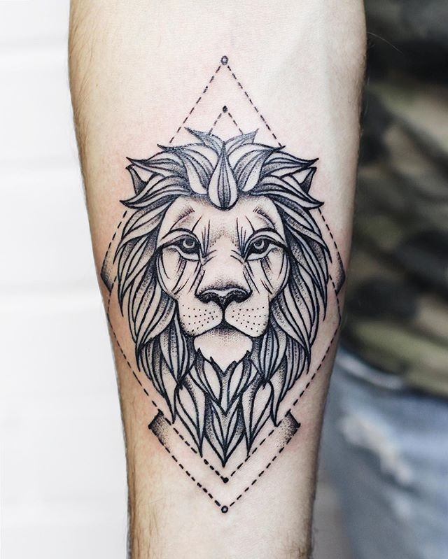 Dot style black ink forearm tattoo of lion with geometrical figures