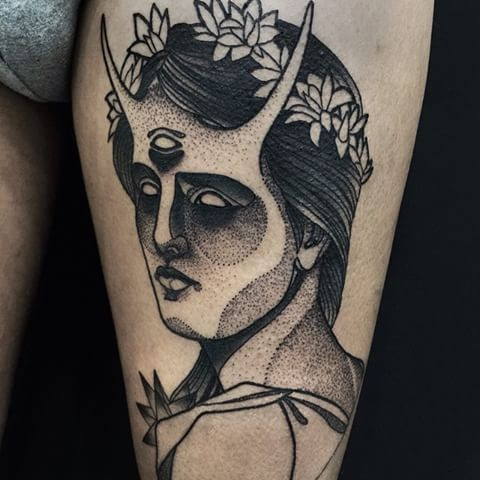 Dot style black ink painted by Michele Zingales thigh tattoo of demonic woman with leaves
