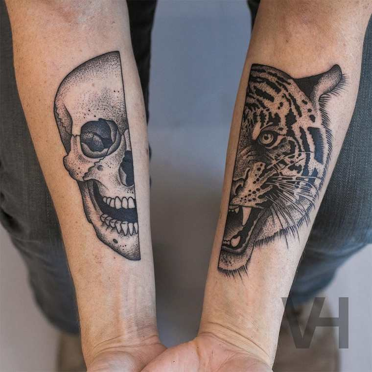 Dot style black ink split forearm tattoo of human and tiger heads by Valentin Hirsch