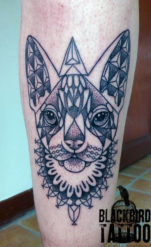 Dot style colored leg tattoo of Egypt cat stylized with ornaments