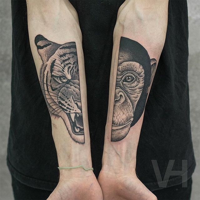 Dot style large forearms tattoo of split monkey head with roaring tiger