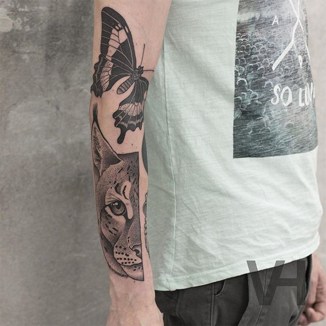 Dot style painted by Valentin Hirsch arm tattoo of split wild cat head