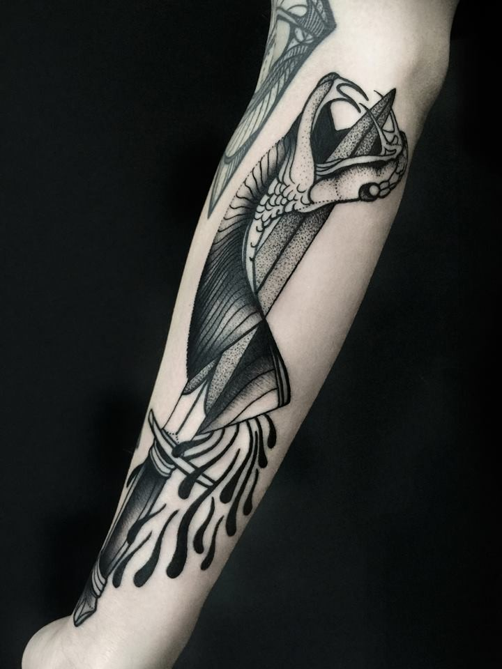 Dotwork style black ink forearm tattoo of dagger with bloody snake by Michele Zingales