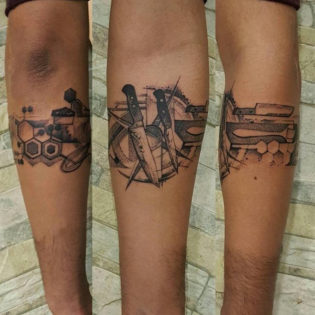 Dotwork style black ink forearm tattoo of knives with geometrical figures