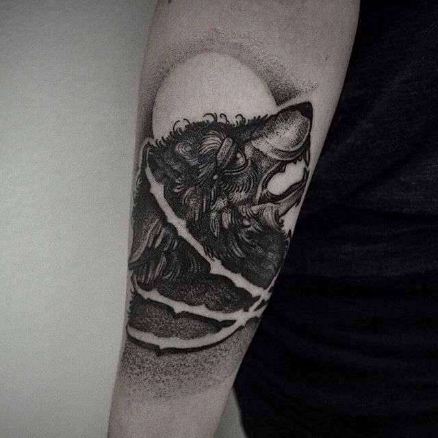 Dotwork style medium size black ink arm tattoo of wolf head