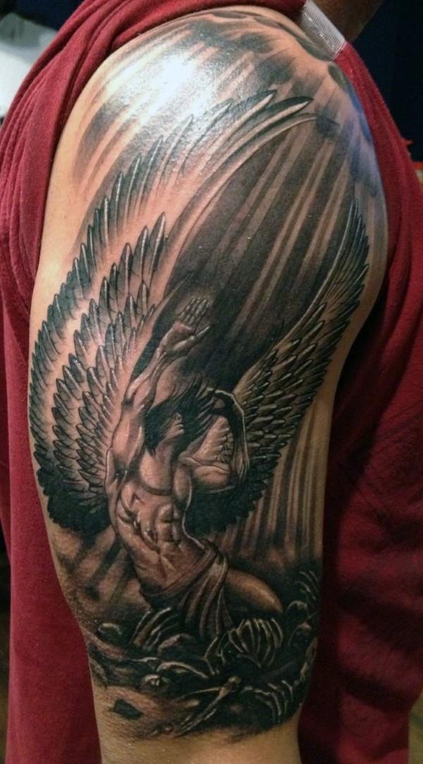 Dramatic big black ink shoulder tattoo of fallen angel