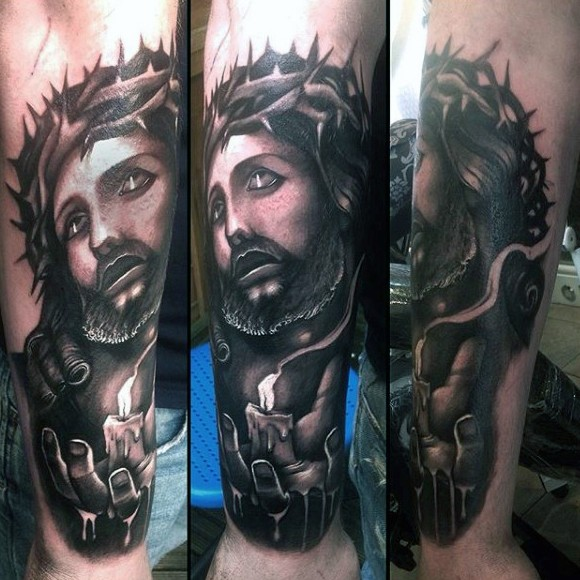Dramatic black and gray style forearm tattoo of Jesus and burning candle