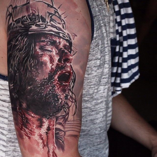 Dramatic christian style bloody jesus tattoo on arm for Jesus tattoos on arm