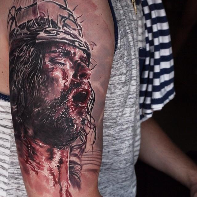 Dramatic Christian style bloody Jesus tattoo on arm
