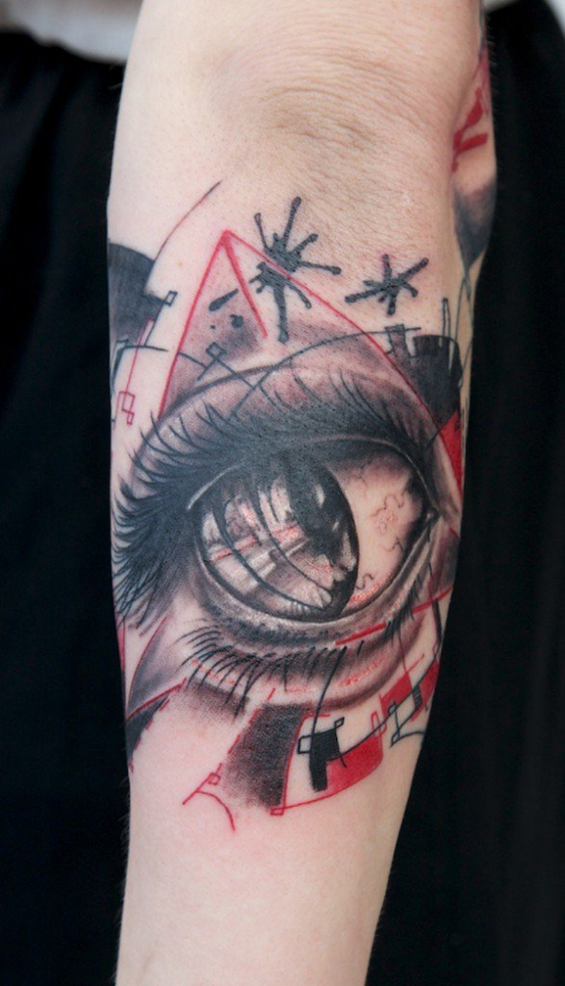 Dramatic little colored eye tattoo on arm