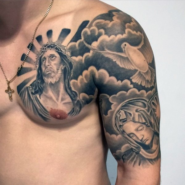Dramatic looking black and white religious style shoulder and chest tattoo