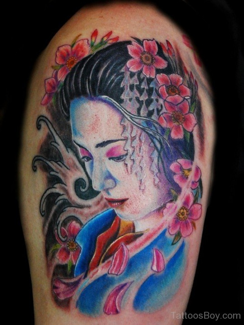 Dramatic natural colored shoulder tattoo of sad geisha portrait