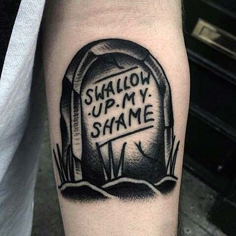 Dramatic painted little black ink tomb stone with lettering tattoo on arm