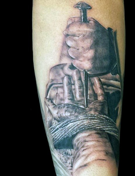Dramatic realism style colored forearm tattoo of hand nailed to the wooden cross