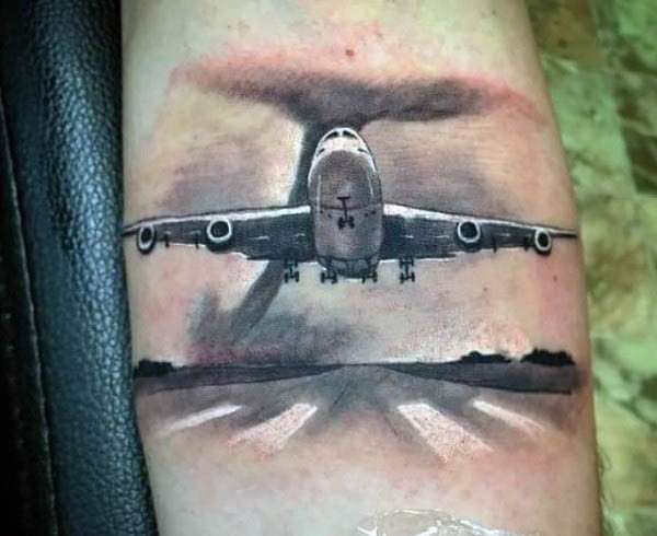 Dramatic realistic looking modern plane tattoo on arm combined with big hurricane